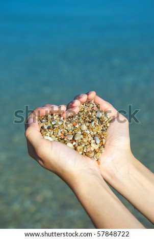 Heart symbol in feminine hand. Conceptual design. - stock photo