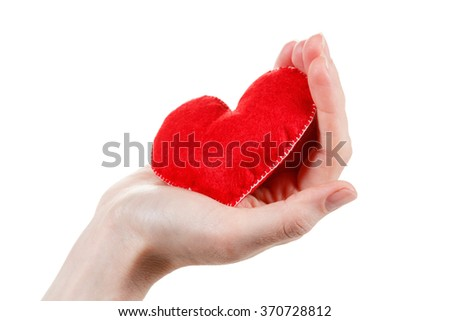 Heart symbol in hands. Concept of health, protection and love. Woman holding heart in her hands. - stock photo
