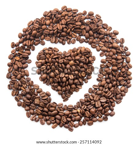 Heart symbol in the form of coffee grains isolated on white background