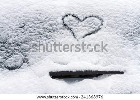 Heart symbol on a car windshield. - stock photo