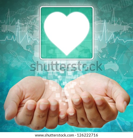 Heart Symbol on hand , medical icon - stock photo