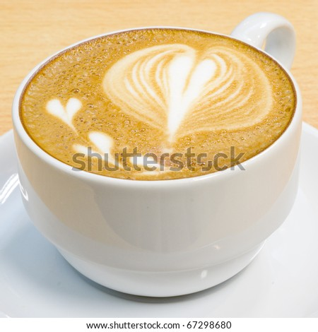 heart symbol on latte coffee cup - stock photo