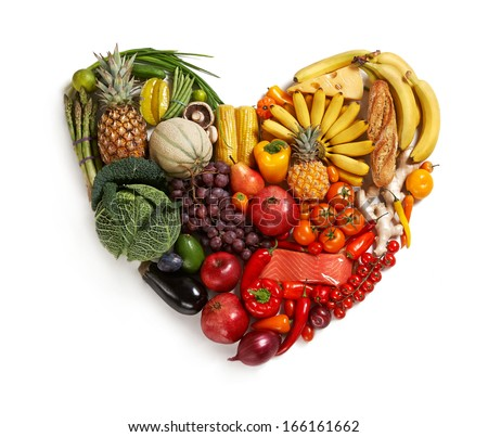 Heart symbol / studio photography of heart made from different fruits and vegetables - on white background