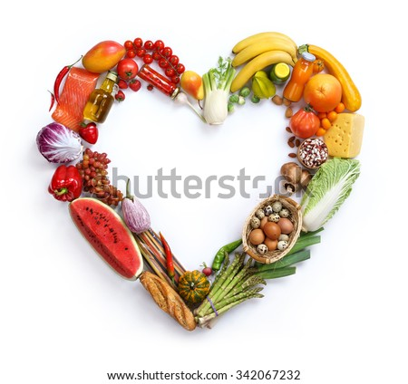 Heart symbol / studio photography of heart made from different fruits and vegetables - on white background, top view. High resolution product, - stock photo