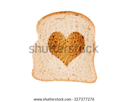 Heart toasted on a slice of bread, isolated on white background