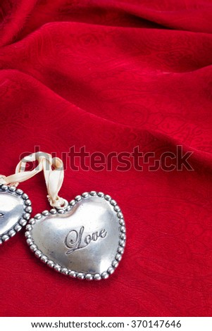 heart with Love word on  red silk background