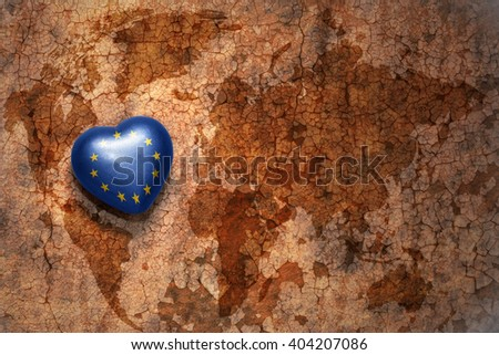 heart with national flag of european union on a vintage world map crack paper background. concept - stock photo