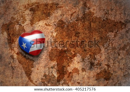 heart with national flag of puerto rico on a vintage world map crack paper background. concept - stock photo