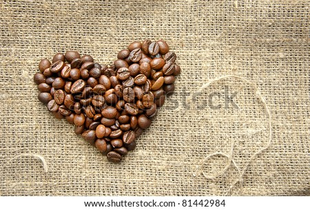 Heart with roasted coffee beans on the burlap background - stock photo