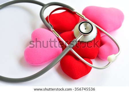 Heart with stethoscope on white background, heart healthy concept  - stock photo