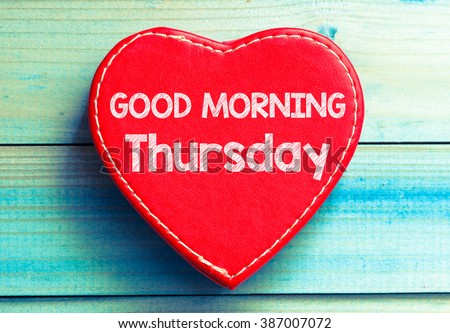 Heart with text Good morning Thursday. Heart with text Good morning Thursday on a wooden background. Vintage style. - stock photo