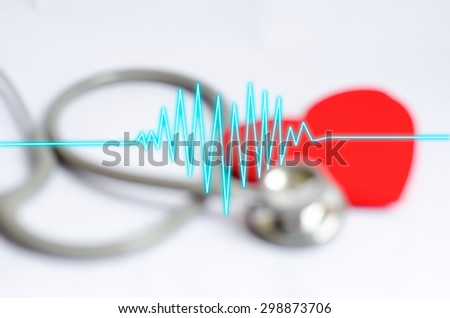 Heartbeat on blur Stethoscope with red heart background - Health care concept - stock photo