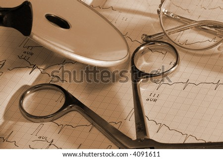 heartbeat trace and Glasses macro - stock photo
