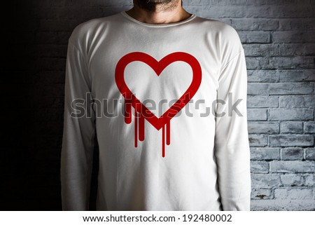 Heartbleed bug symbol on white shirt. Male hacker in dark room.