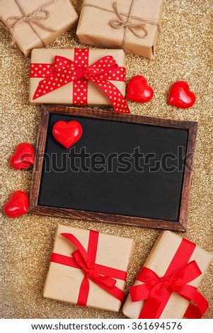 hearts and box for present on wooden background