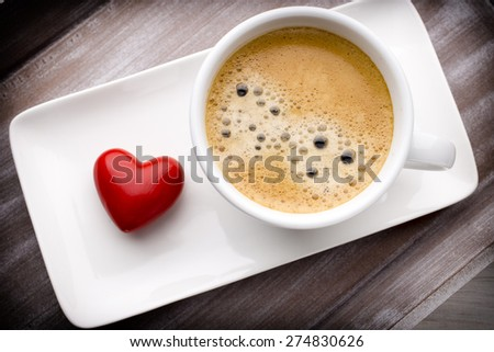 Hearts and coffee on the table, greeting card.