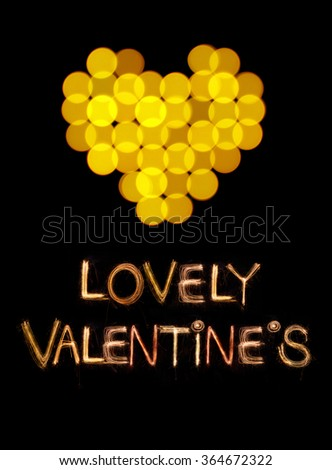 Hearts bokeh shape and Valentine word Sparkle firework over black background for Valentine's day - stock photo
