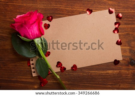Hearts, flower and greeting card on wooden background in vintage style, selective focus - stock photo