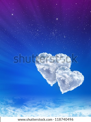 Hearts in clouds against a blue spacing sky - stock photo