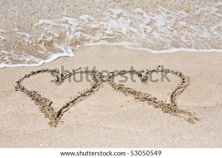 Hearts on the sand - stock photo