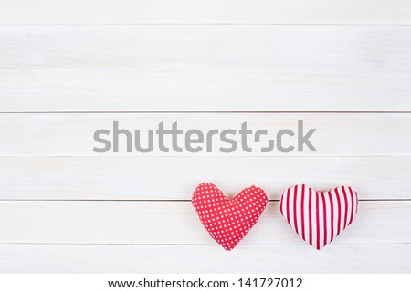 Hearts on white wood background - stock photo