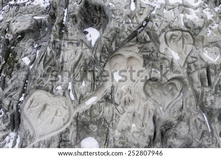 Hearts Scratched in Stone Photo