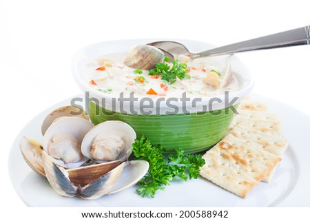 hearty bowl of homemade chowder with fresh steamed clams and soda biscuits - stock photo