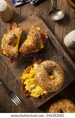 Hearty Breakfast Sandwich on a Bagel with Egg Bacon and Cheese - stock photo