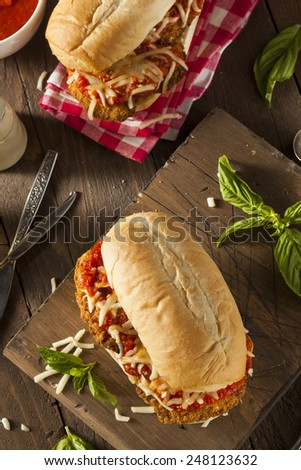 Hearty Homemade Chicken Parmesan Sandwich with Marinara and Cheese - stock photo