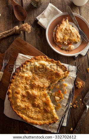 Hearty Homemade Chicken Pot Pie with Peas and Carrots - stock photo