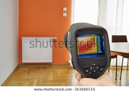 Heat loss Detection in Central Heating Radiator - stock photo