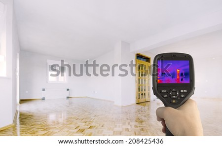 Heat Loss Detection of the House With Infrared Thermal Camera - stock photo