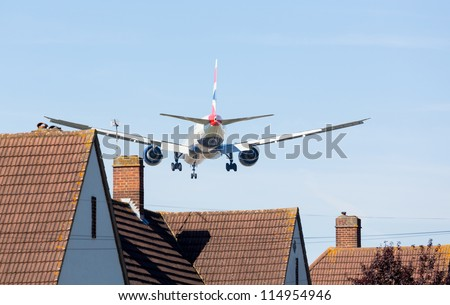 HEATHROW AIRPORT, LONDON - 9 SEPTEMBER: British Airways Boeing 777 approaches Heathrow on 9 September 2012. London Heathrow is the world's third busiest airport and a new runway is under discussion. - stock photo