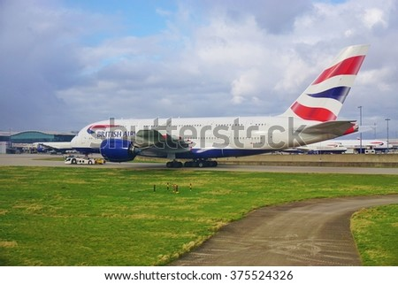 HEATHROW, ENGLAND -3 FEBRUARY 2016- An Airbus A380 jumbo jet airplane at the London Heathrow International Airport (LHR). - stock photo