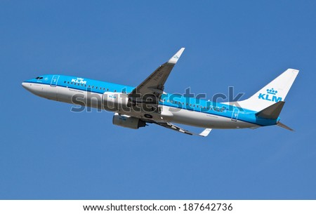 HEATHROW, LONDON, UK - April 10: Royal Dutch Airlines KLM Boeing 737 (PH-BXI) taking off on April 10, 2014 at London Heathrow Airport, London, UK.  - stock photo