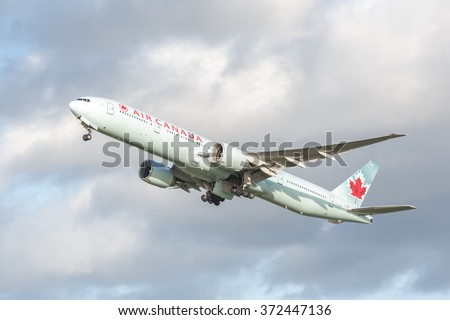 HEATHROW, LONDON, UK - JANUARY 28: Air Canada Boeing 777-333 (C-FIVW) in Arctic green livery, bound for Vancouver International Airport, Canada departing from Heathrow, London, UK on January 28, 2016 - stock photo