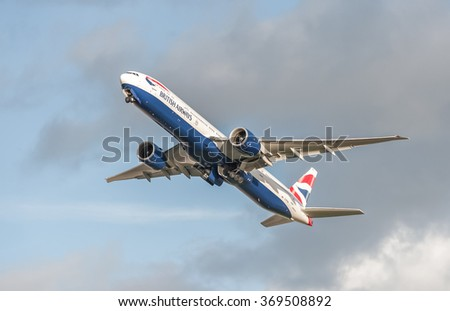HEATHROW, LONDON, UK - JANUARY 28: British Airways Boeing 777 retracting its undercarriage on take-off from Heathrow Airport, London, UK on January 28, 2016