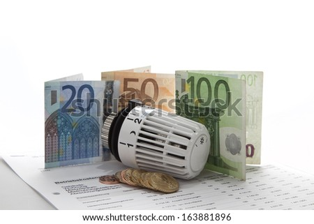 Heating concept with thermostat and banknotes - stock photo