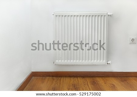 Heating radiator detail against white wall