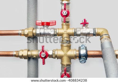 Heating systems cooper pipes ball valves stock photo for Water line pipe material