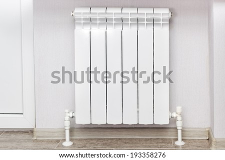 Heating white radiator radiator in living room. - stock photo