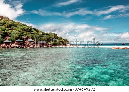Heaven on earth.The Island of Thailand . The ocean and the strip of land . Paradise core Bungalow . Perfect vacation . The dream of many people . - stock photo
