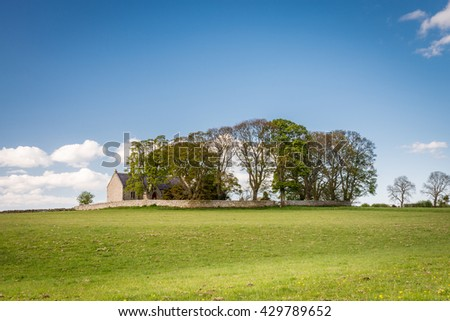Heavenfield Church on Hilltop / A delightful hilltop church in Northumberland believed to be the location where King Oswald raised a large wooden cross before the Battle of Heavenfield AD 635 - stock photo