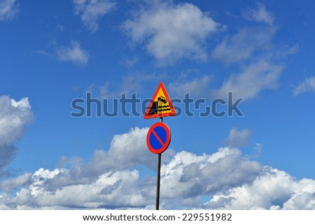 """Heavenly landscape with traffic warning signs """"Quayside or ferry berth"""" and """"No parking"""" - stock photo"""