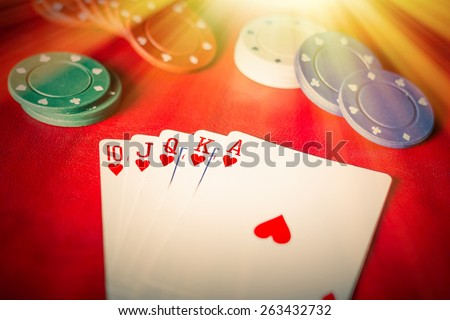 Heavenly light illuminates a winning hand in this poker background photo - stock photo