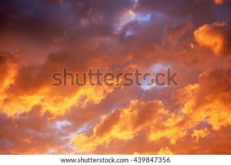 Heavenly sunset golden, orange and purple light sky background. Idyllic beautiful sky with thunderclouds.  - stock photo