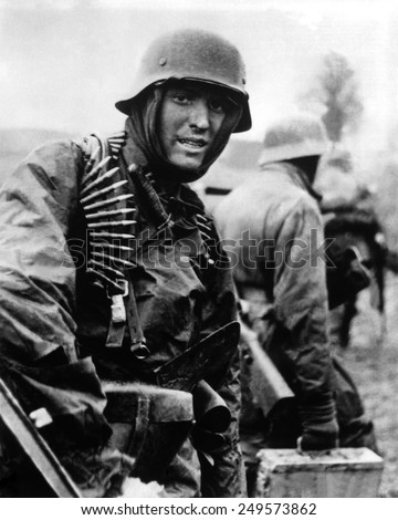 Heavily armed German soldiers advancing in Belgium through thin American lines. Dec. 16-22, 1944. Still from a captured German film. Battle of the Bulge, World War 2. - stock photo