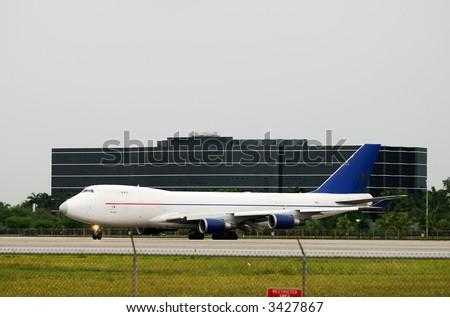 Heavy cargo jet (Boeing 747 jumbo) - stock photo