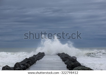 Heavy clouds and windy weather at Biarritz Beach in France. 2014 - stock photo