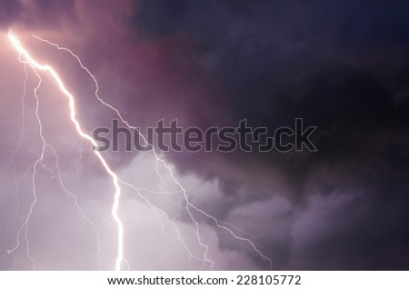 Heavy clouds bringing thunder, lightnings and storm. - stock photo